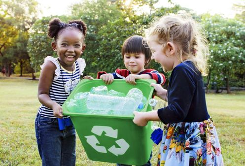 Children holding recycling bin